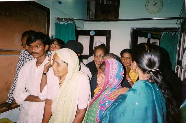 RElatives listening to Dr. Layeequr Rahman Carefully