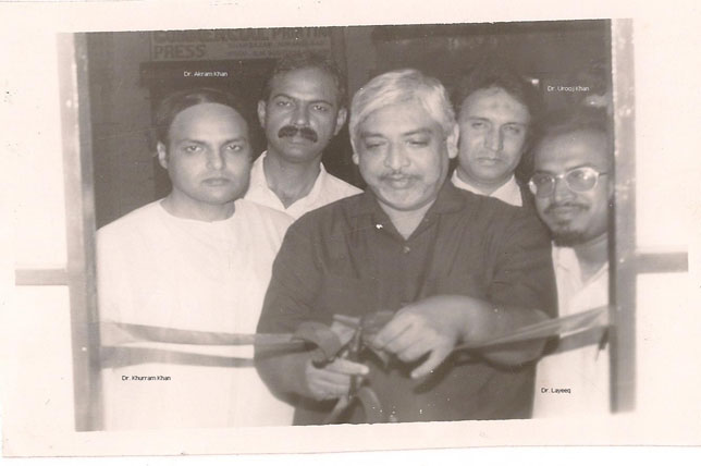 Dr. Talib Sir cutting ribbon